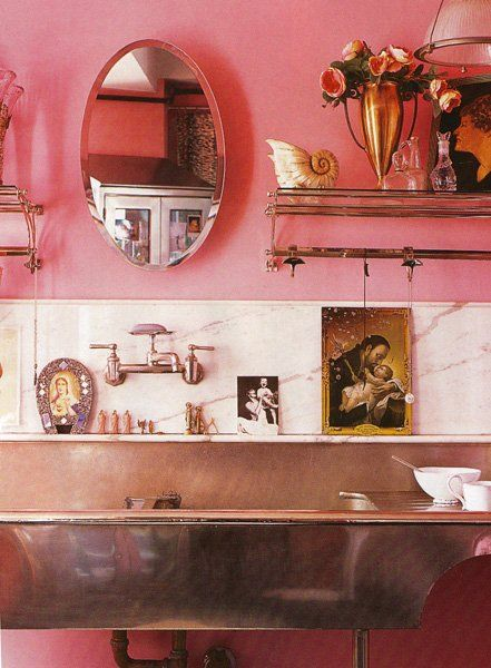 In an unexpected spot, without hesitation. This image from Elle Decoration UK via This Is Glamorous of the kitchen of Betsey Johnson's former NYC home shows off how embracing bubble gum pink walls can work, even in this unexpected room. While the white marble backsplash and stainless steel tone the color down a notch visually, the roses and religious iconography underline the quirky (but beautiful!) choice.
