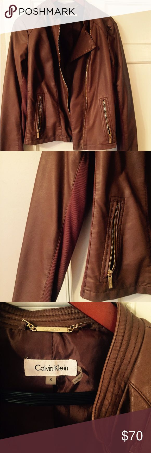 Caramel brown Calvin Klein leather jacket Soft caramel brown Calvin Klein leather jacket. Has stretch material on sleeves and gold zippers. Never worn Calvin Klein Collection Jackets & Coats