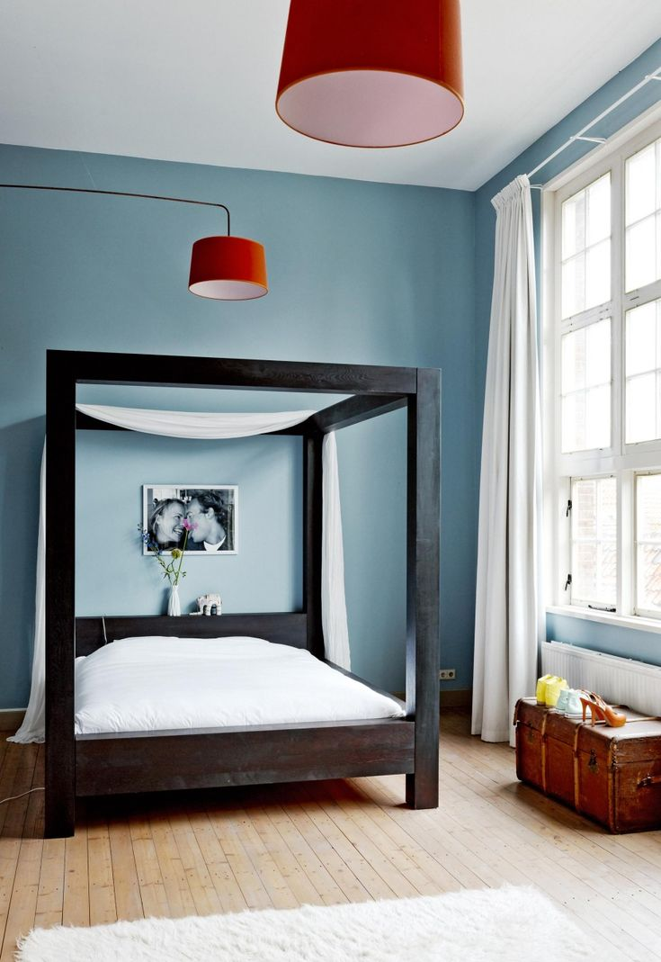 Blue bedroom with a black four-poster bed | Styling Kim van Rossenberg | Photographer Ernie Enkelaar | vtwonen June 2015