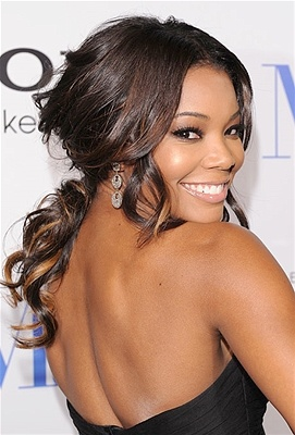 Gabrielle Union's smile says it all. Confident, playful and undeniably romantic, her look is one that would work well for brides with long hair and a strapless neckline.