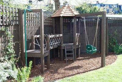"""Timber Play frame - Every kid dreams of having a treehouse for outdoor play, but not every yard has the right kind a tree. But how about a kid-sized playhouse? Playhouses can be any shape or style to be just right for any child. Add a """"kitchen"""" and seating for them to entertain their friends and they might never want to come in the """"big"""" house."""