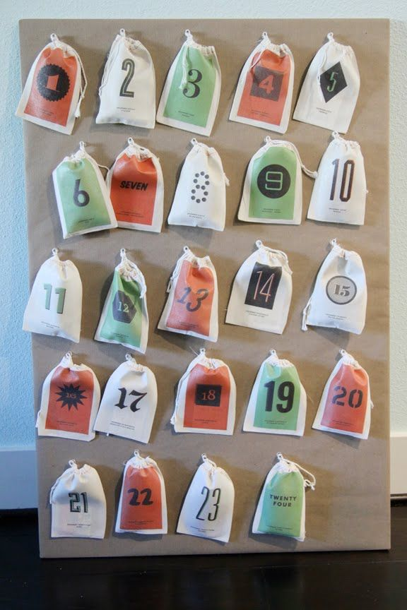 downloadable advent calander. Put on canvas bags. Inside you put a little present and a card with a holiday related activity to do with the family. Im sorry...this is just adorable...