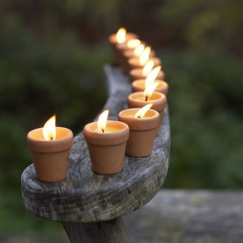 little clay pots used as candle holders
