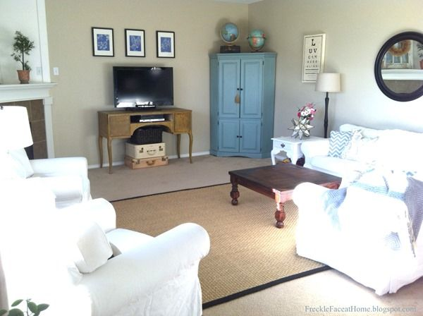 Grant Beige by Benjamin Moore.  The cupboard in the living room is painted Halycon Green by Sherwin Williams