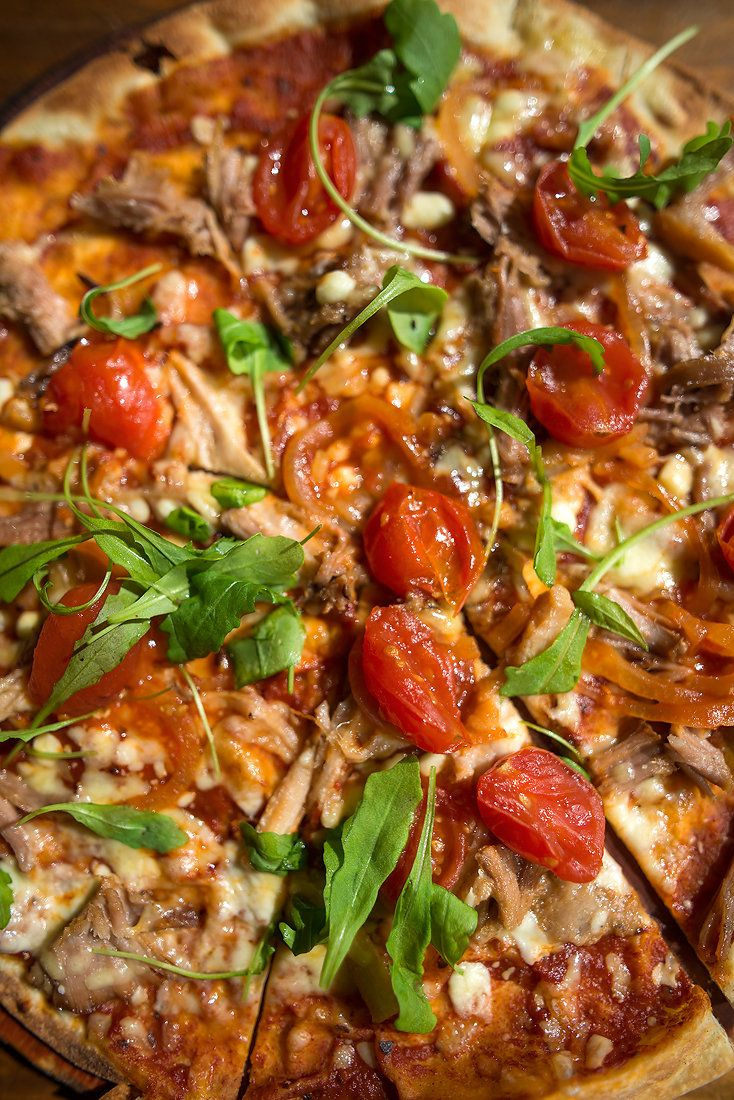 Pulled Pork and Smoked Tomato relish - delish new pizza on #ShimmyWinterMenu Shimmy Beach Club restaurant with gorgeous ocean views.  www.shimmybeachclub.com to book
