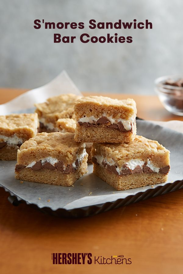 S'mores Sandwich Bar Cookies are fun for the kids and easy to make. Made with HERSHEY'S Milk Chocolate Bars, graham cracker crumbs, and miniature marshmallows, these cookies will soon be a classic. Nothing like S'more Fun even in the fall and winter.