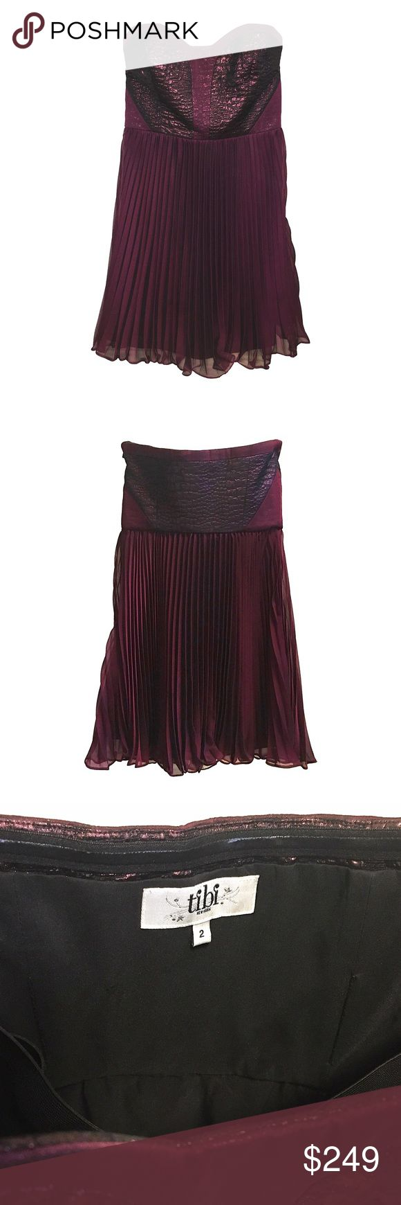 "Tibi Bond St. Strapless Plisse Mini Dress Tibi Bond St. Strapless Dress  This strapless dress features organza overlays and boning at the quilted lamé bodice. Sweetheart neckline and accordion-pleated skirt. Hidden side zip and built-in bra strap. Fully Lined.  - Plum croc-embossed metallic jacquard bodice with satin skirt - 22"" long, measured from center back - Strapless sweetheart neckline - Empire waist - Smooth V panels cinch in waist - A-line plisse skirt - Fabrication: Lamé/organza…"