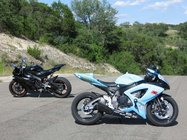 A pair of sportsbikes pretending to ignore each other- yamaha yzf-r6 and suzuki gsx-r1000 k7