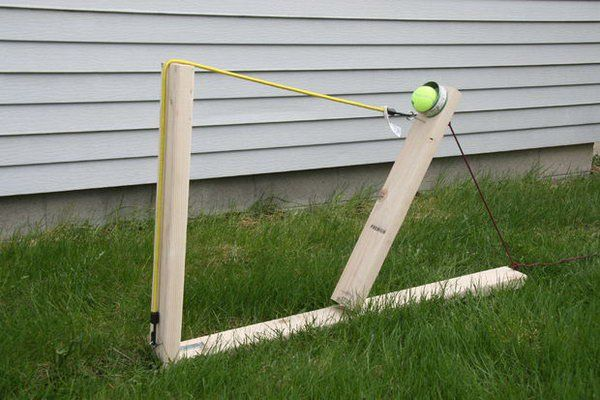 Wooden Catapult Water Balloon Launcher. Create the base, attach the can to throw, eye bolts and attach the rope and bungee cord to finish off this balloon launcher. It's easy yet can launch your water balloon quickly.