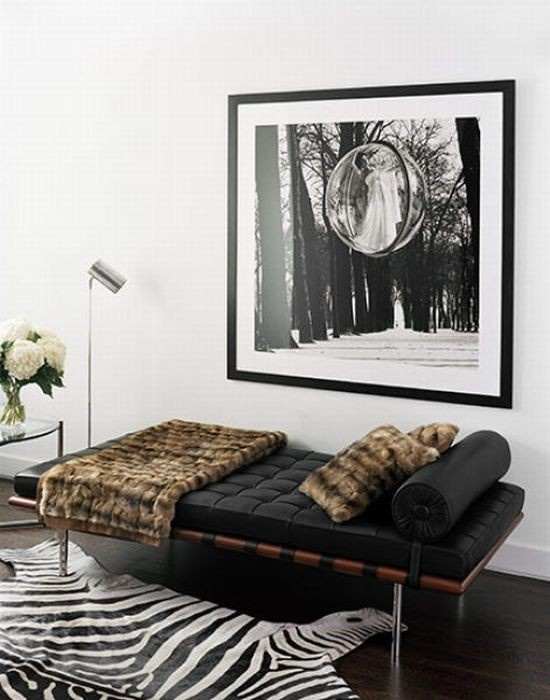 Predominantly monochrome scheme - the throw and pillows gives added warmth to the space.