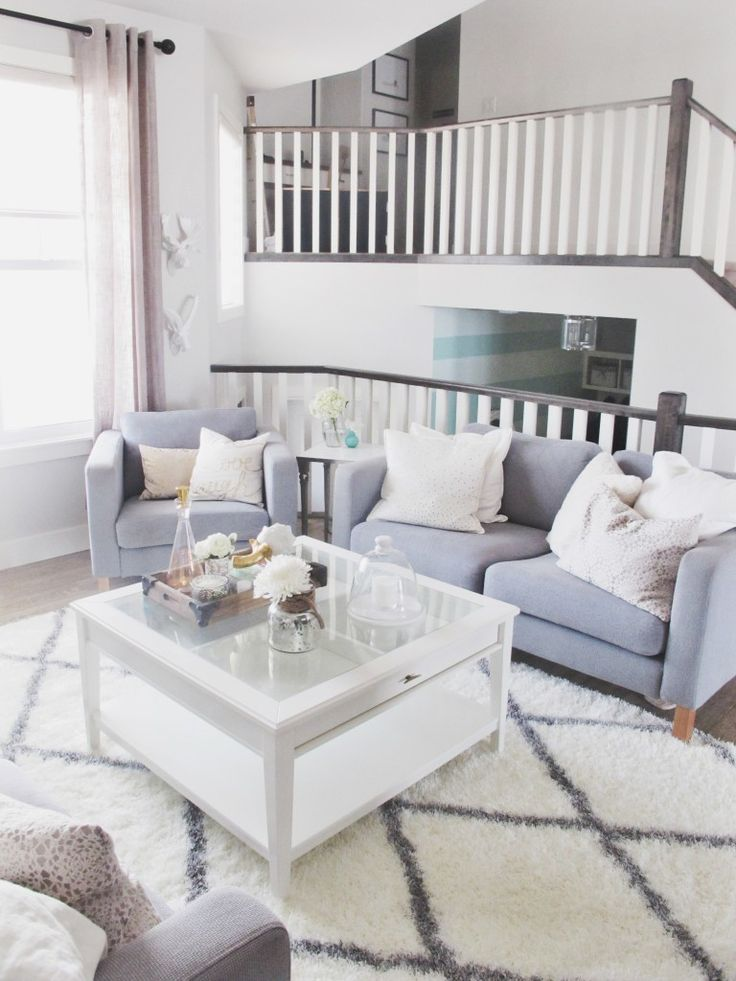 living room decor blue couch and trellis rug