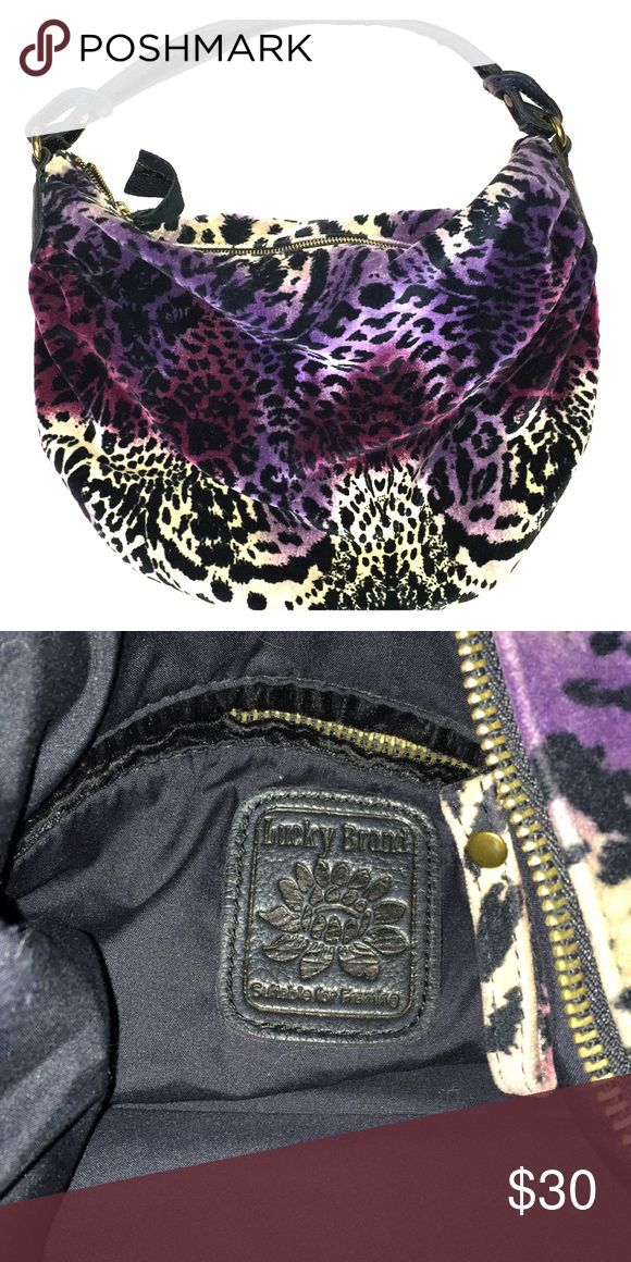 Funky Lucky Brand Purse Bold purple, magenta, and tan coloring make up this Lucky Brand Purse. Tons of room inside. Lucky Brand Bags Hobos