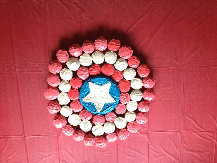 Had this idea for Kimber's cupcakes.  Captain America Cupcake Shield