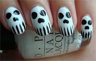 Skulls for Halloween. Spooky nail art design.