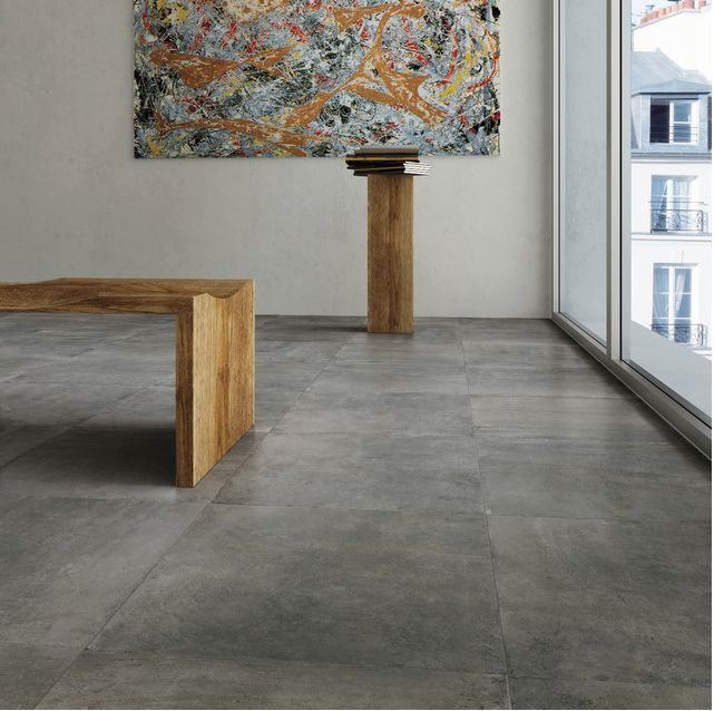 Tile that looks like concrete - http://www.houzz.com/photos/1204402/Nextra-colored-body-concrete-look-with-soft-variaton-in-a-contemporary-palette-modern-wall-and-floor-tile-san-francisco