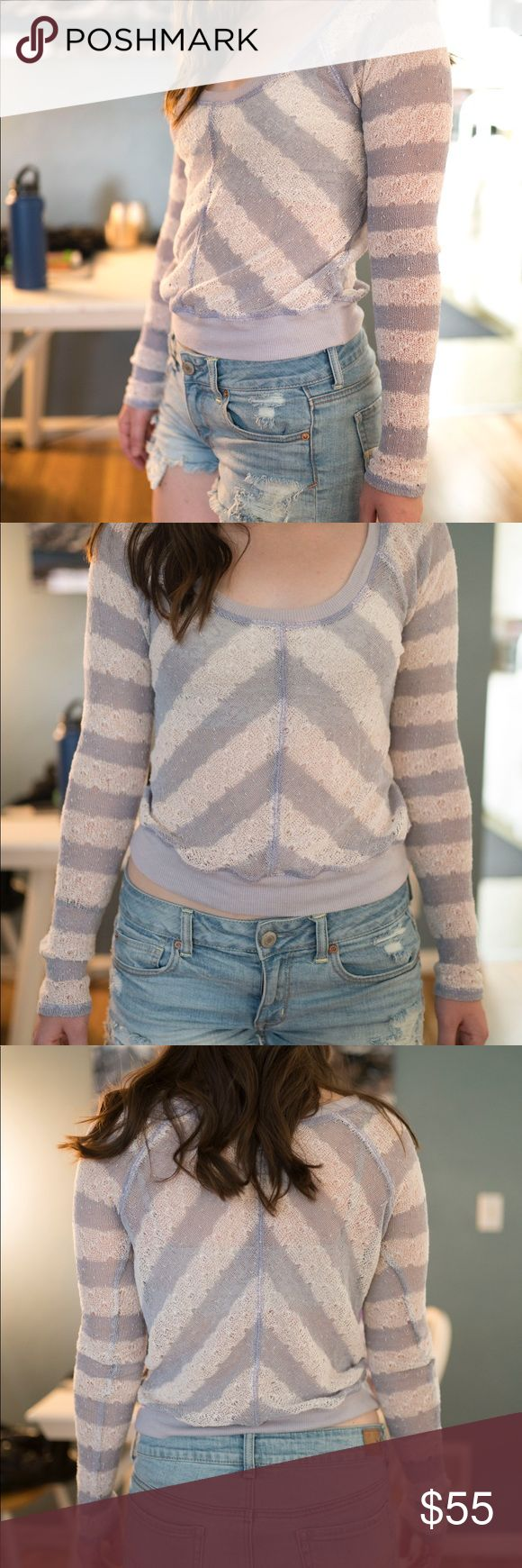 Free People striped long sleeved top. Size S Stripped lavender and white long sleeved shirt. Size S with tighter sleeves and shorter at the waistline. Loose knit. Worn only a few times with no flaws Free People Tops Tees - Long Sleeve