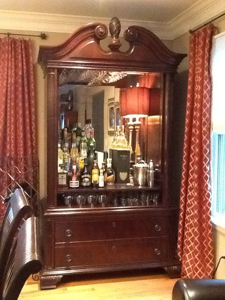 Turned bedroom TV armoire into a bar.