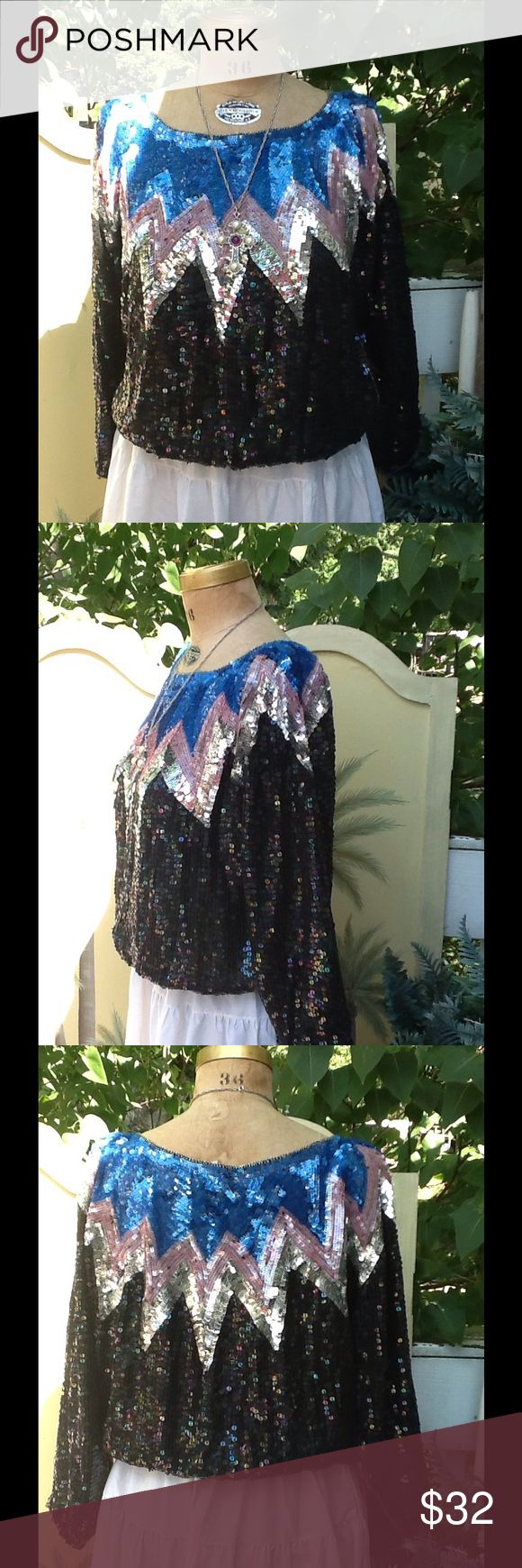 "VTG 70s FULLY SEQUINED & SILK HIPPIE TOP This is GORGEOUS!!!its from the 70s,it's a fully sequined & silk hippie top..these were very popular back then we wore these all the time with jeans,it's in a predominantly black with pink,silver & blue sequins,shoulder pads, ELASTICIZED bottom hem and sleeve cuffs,it's made in India by Metaamorphosis, SZ M..excellent condition these didnt usually survive very well for how often we wore them a lot of sequins ended up missing! Measurements: L:22""…"
