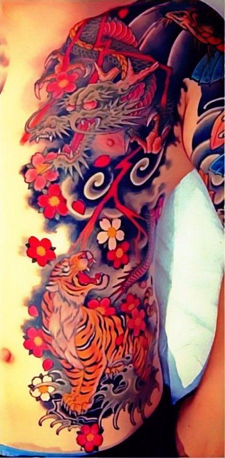 Tiger-Dragon tatoo by Chris Garver.                              …