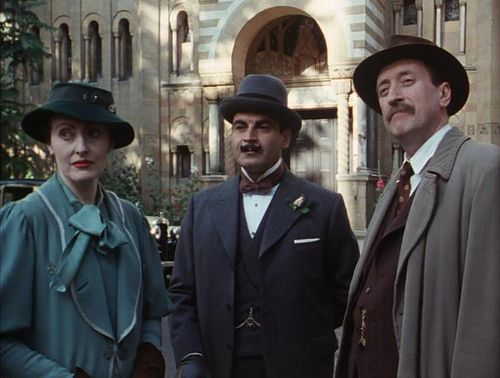 A dapper trio from Agatha Christie's Poirot: Miss Lemon, Hercules Poirot, and Chief Inspector Japp.