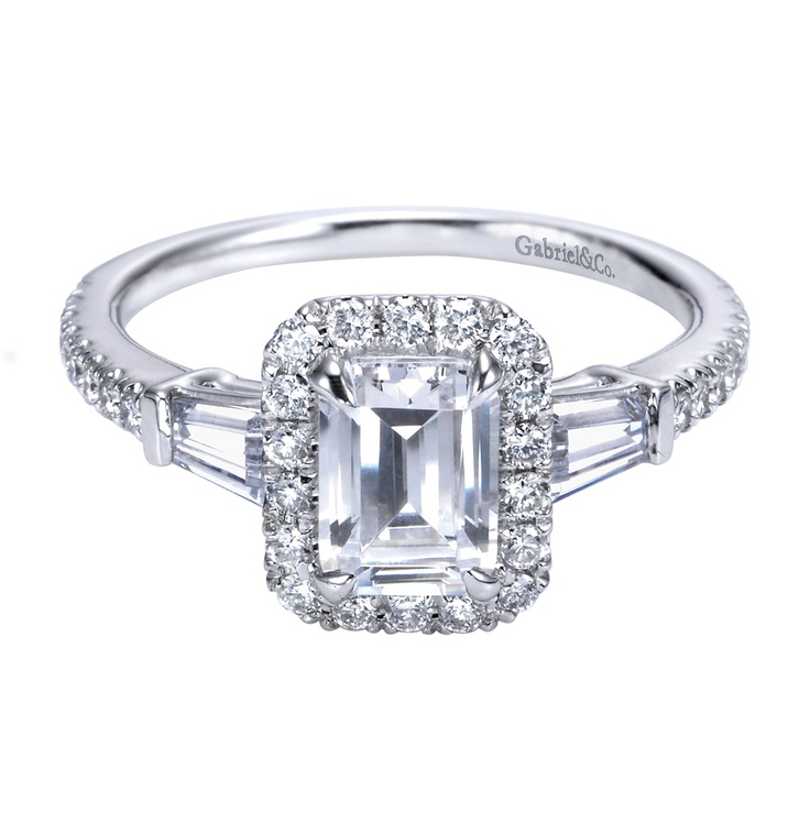 Vintage style platinum halo ring with an emerald cut center diamond
