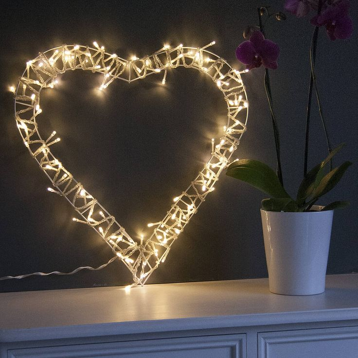 This beautiful heart wreath is decorated with soft white fairy lights around a pretty white metal frame.The multifunctional fairy lights give you the option to choose from several settings, including classic static lights, twinkle or slow fade. You can choose your favourite or change the mood whenever you likeA stylish decoration for your home all year round, this fairy light wreath adds a little something extra to any room. Whether hung on the wall or placed on a hard surface, such as a ...