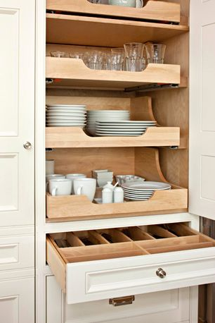 Sliding cabinet shelves for dishes and flatware. Designed by Colleen McGill