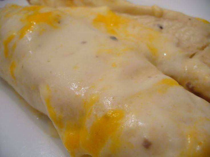 Famous Chicken Enchiladas (with white cheese sauce)