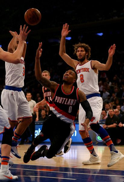 Robin Lopez Photos - Damian Lillard #0 of the Portland Trail Blazers makes the shot as Jose Calderon #3 and Robin Lopez #8 of the New York Knicks defend at Madison Square Garden on March 1, 2016 in New York City. NOTE TO USER: User expressly acknowledges and agrees that, by downloading and or using this photograph, User is consenting to the terms and conditions of the Getty Images License Agreement. - Portland Trail Blazers v New York Knicks