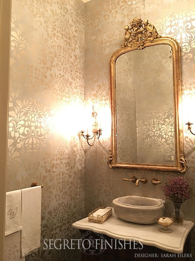 Stenciling over plaster with metallic paint gives the most romantic glow to any room! This application was perfect to marry the formal elements in this powder by designer Sarah Eilers.