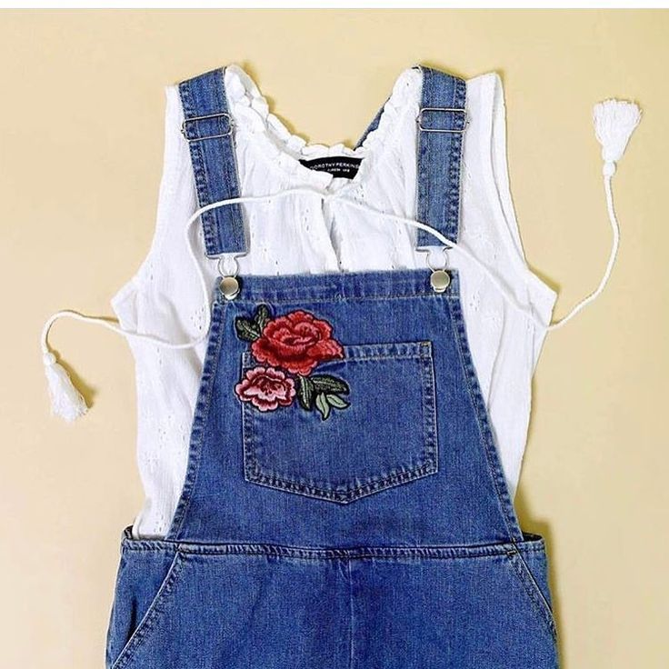 An adorable look for Spring. Denim Dungaree Dress + White Ruffle Top. LOVE! #springdenim