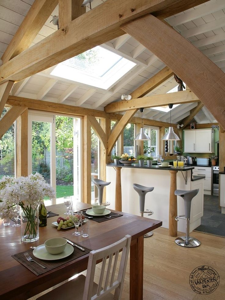 An oak extension on a 1930's semi house, giving additional living space and large kitchen. A wall of glazing links the lean-to oak extension to the garden. By Carpenter Oak