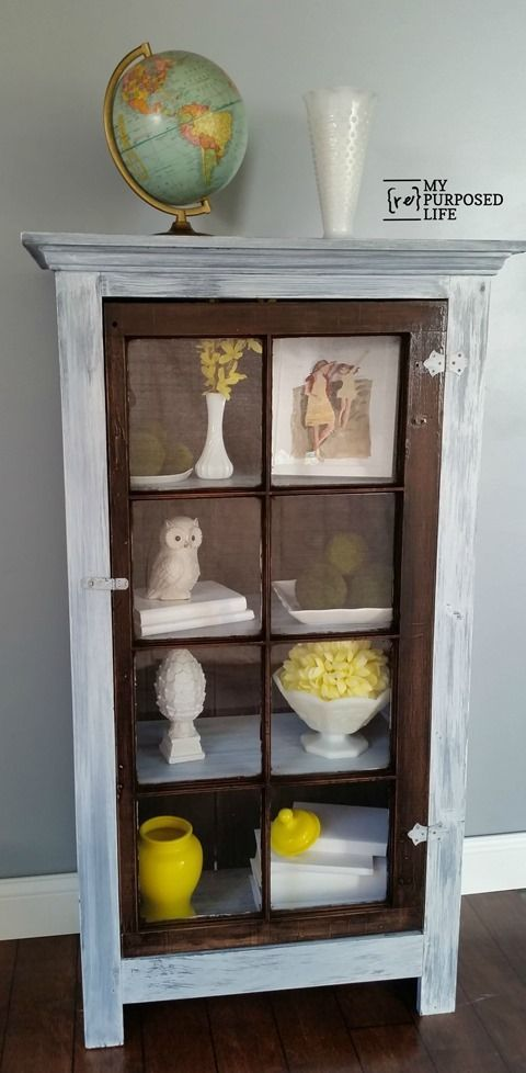 built from scratch using odd pieces and an old window, I love this great storage cupboard.: