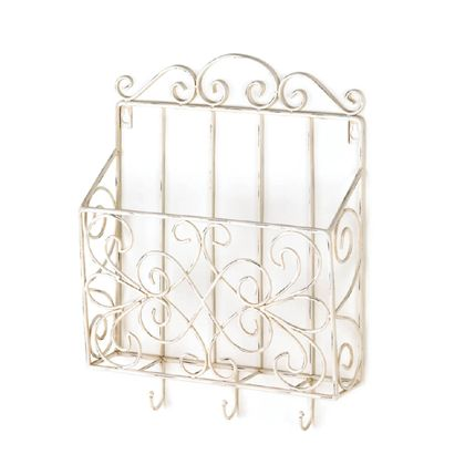 Keep magazines, today's mail or your daily must-haves organized with this pretty vintage-style wall rack. The scrolling metal frame is painted in weathered white, and the rack features three small hooks at the bottom perfect for hanging your keys, umbrellas, and more.