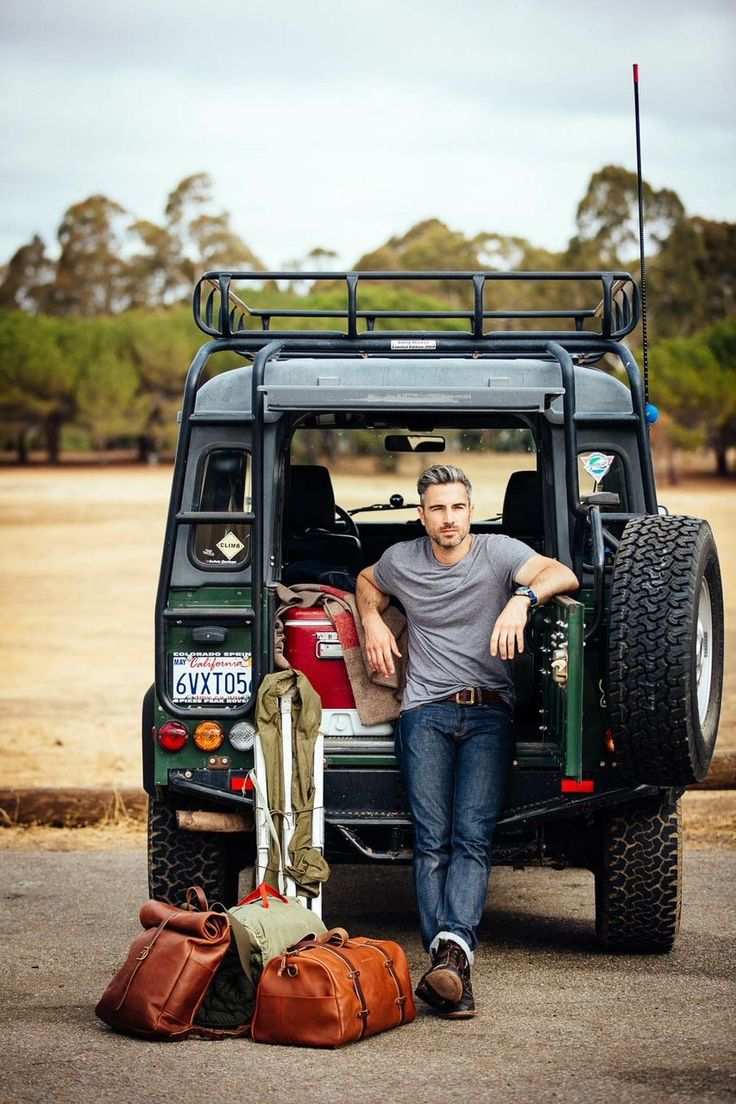 California Silver Fox with camping gear and Land Rover.