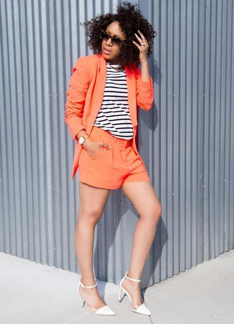 Mattie James in a colourful short and jacket combo.