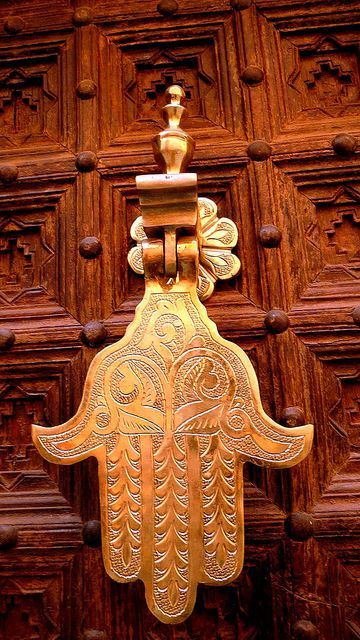 Hamsa door knocker ~ The Hamsa evokes spring, abundance and the Garden of Eden. It is a good luck symbol traditional in the Metditerranean and Middle East.