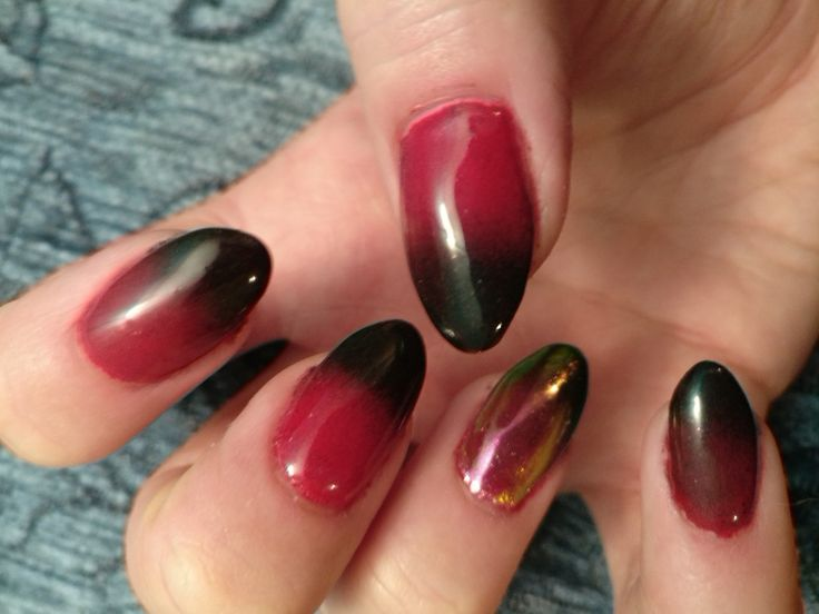 black and red pigment with unicorn on ring finger