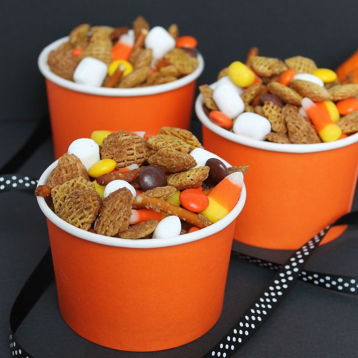 FALL SNACK MIX: 6 cups Chex or Crispix cereal 1 cup pretzels 6 tablespoons butter, melted 1/4 cup brown sugar 1 tsp cinnamon 1 cup Reese's pieces or M+M's 1 cup mini marshmallows 1 cup candy corn
