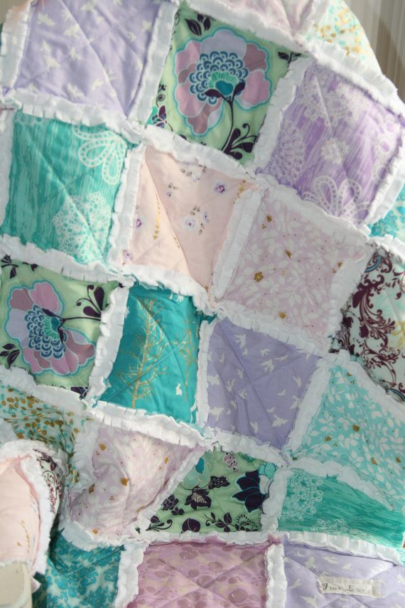 Wrap your baby in love with this soft and cozy rag quilt! I used a combination of Brambleberry Ridge fabrics and a few cotton prints to make this one