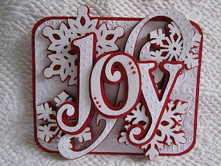 """Made with cricut cuts: Winter Woodland """"Joy"""" plus snowflakes from WInter Lace and a swirl from Ashlyn's Alphabet on a rounded rectangle from George"""