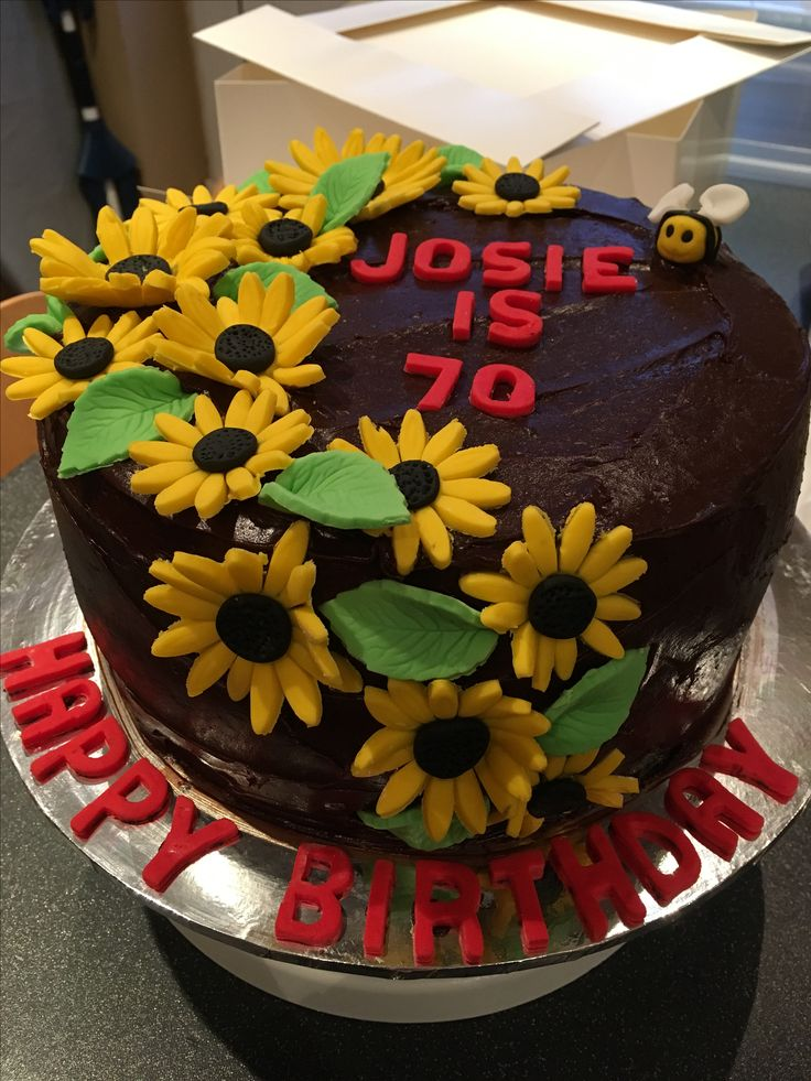Chocolate cake covered in chocolate fudge icing with sugar paste flowers.