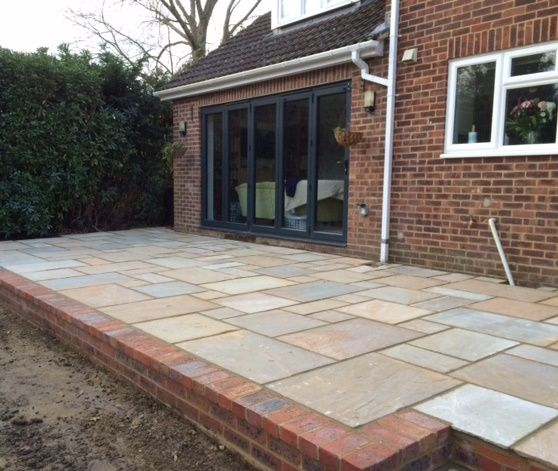 Freshly Laid Patio Using Natural Riven Sandstone In Harvest; Grass Now  Required!