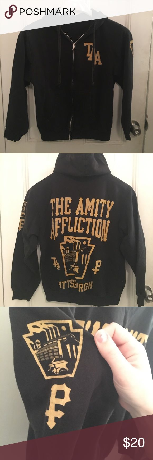 The Amity Affliction Pittsburgh Zip up Hoodie Black and gold Amity Affliction hoodie. Washed a few times, some normal wear and tear. Front chest TAA logo, graphic on sleeve, and back print. Tops Sweatshirts & Hoodies
