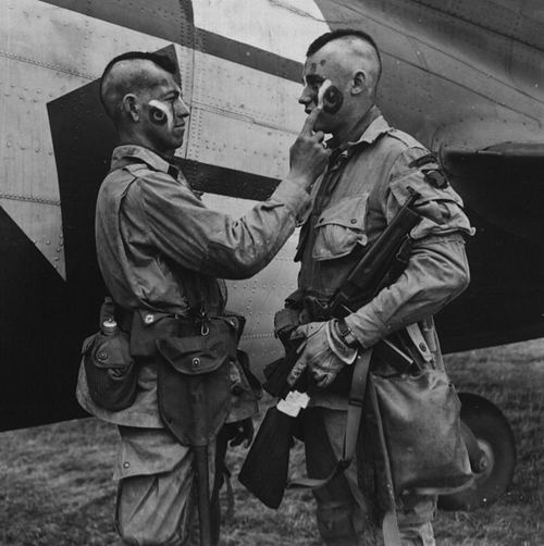 Paratroopers of the 101st Airborne Division, 1944, going native in order to spread fear and terror into the hearts of the German enemy.
