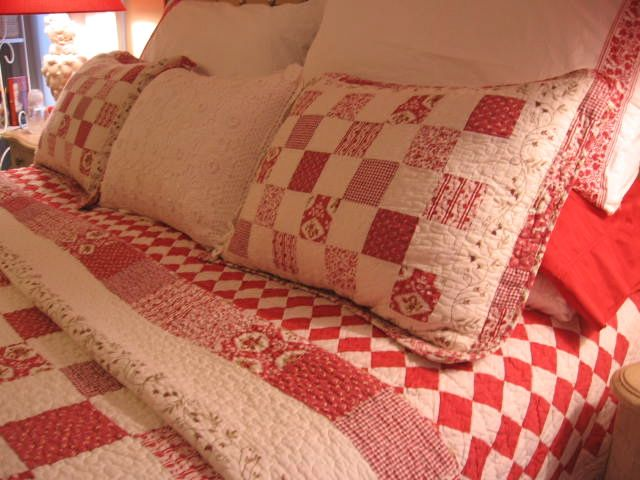 cozy red and white quilted bedding