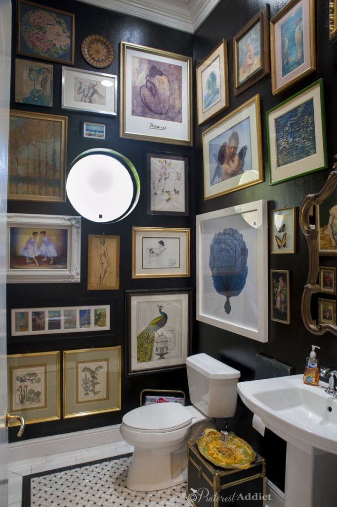 Love this tiny art gallery in the guest bathroom!