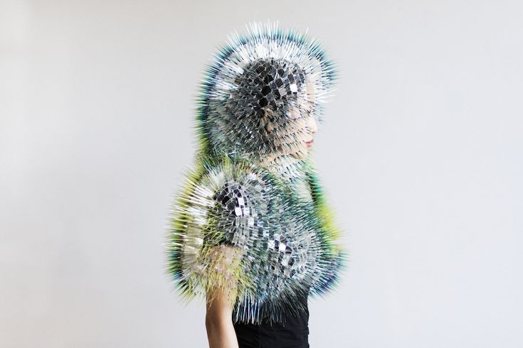 Maiko Takeda's creations seem like a surreal creatures from fantastic dream world. The headpieces of her latest creation, 'Atmospheric Reentry', are excitingly different, delicate and futuristic. The Tokyo born graduate of Central Saint Martins and the Royal College of Art, seeks to 'create surreal, subtle dramas around the person wearing a piece and the people near them'.