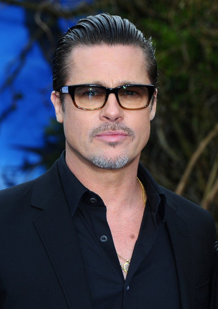 Pin for Later: 52 Years of Epic Brad Pitt Hotness  Brad sported his now-signature tinted glasses at an event for Angelina's film, Maleficent, in London in May 2014.