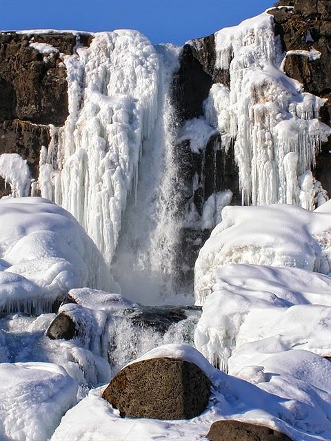Frozen waterfall Oxarafoss, National park Thingvellir, Iceland   See More Pictures